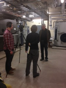 Bob describes the hospital's geothermal heating system to PBS